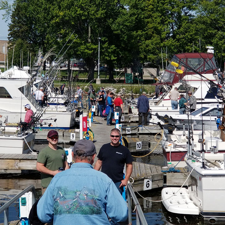 close up of multiple people getting ready to go salmon fishing