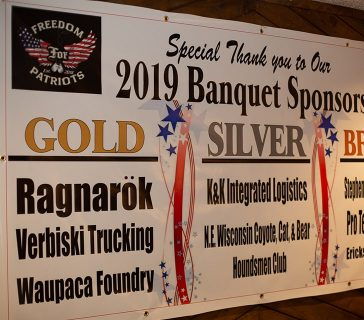 banner listing gold, silver, and bronze sponsors of the 2019 banquet