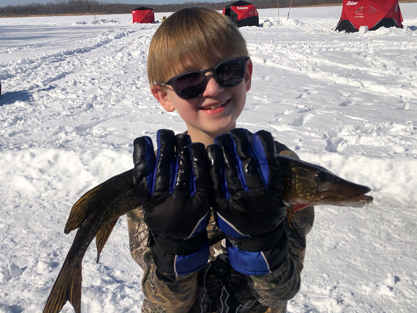 child holding pike